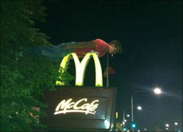 On top of a McDonald's sign