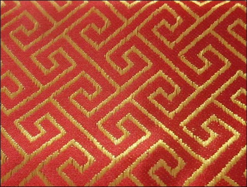 red-and-gold-asian-textile-pattern
